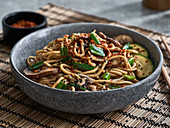 An udon noodle bowl with vegetables