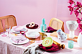 A table laid in pink with melon and peach