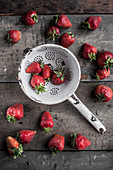 Raw strawberries on an old wooden surface