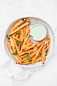 Sweet potato fries served with jalapeno yoghurt sauce and fresh cilantro