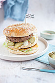 Vegan burger served with iceberg lettuce, pickles, special sauce and vegan cheese