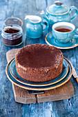 Chocolate cheesecake on blue background