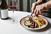 Pasture-fed porterhouse steak with Café de Paris butter and golden fries