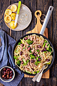 Spaghetti with broccoli, tuna, lemon and olives