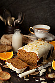 Cut into Vegan Orange and Ginger Cake with Glace Icing