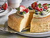 A cotton cake garnished with cream and berries