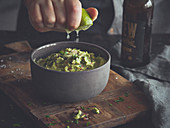Guacamole being drizzled with lime juice