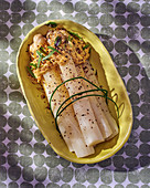 White asparagus with citrus cream cheese and ground pepper