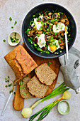 Eggs with mushrooms and spinach a pan dish breakfast