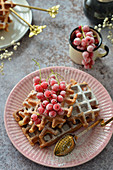 Waffles on a plate with frozen fruits Frozen currants on waffles