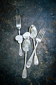 Vintage cutlery on dark surface