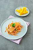 Salmon on a carrot salad with polenta chips