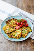 Courgette fritters with tomato salad