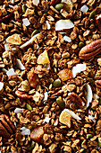Granola with coconut chips, pecan nuts and pumpkin seeds