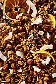 Granola with dried oranges, hazelnuts and coconut chips