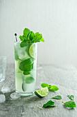 Mojito cocktail with lime, brown sugar and mint