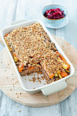 Buckwheat bake with a nut crust and beetroot salad