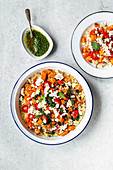 Couscous with oven-roasted vegetables, tomatoes and feta cheese