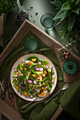 Spring salad with eggs, asparagus, new potatoes, radish, microgreens and little gem lettuce
