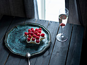 A star shaped ricotta cake with raspberries and a glass of champage