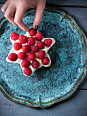 A star shaped ricotta cake with raspberries