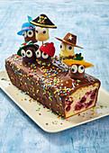 Banana cake decorated with chocolate marshmallow men