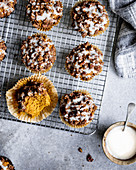 Gluten free spiced pumpkin muffins with pecan streusel and maple yogurt glaze