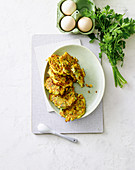 Vegetarian corn and millet fritters with gouda
