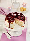 A profiterole cake with a cherry topping