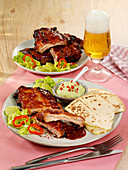 Barbecue spare ribs with guacamole and quesadillas