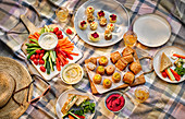 A picnic with crudites, pastries and sandwiches