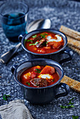 Winter goulash soup in blue soup cups
