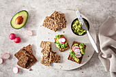 Keto crispbread with avocado cream and radishes
