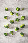 Broccoli florets on a grey surface