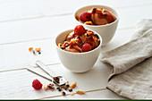Chocolate ice cream with caramel sauce and cocoa nib and peanut brittle