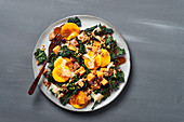 Tuscan kale salad with sweet potatoes, mango and ginger