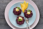 Vegan blueberry and coconut panna cotta with mango and coconut