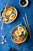 Miso soup with pak choy, carrot, soba pasta, lemon oyster mushrooms, egg and black sesame seeds