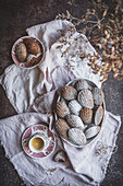 Appetizing sweet cookies served with powdered powder on table with cup of tea