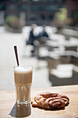 A Franzbrötchen (cinnamon pastry) and a cafe latte in Hafencity, Hamburg, Germany