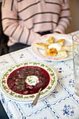 Borscht with sour cream and pierogi