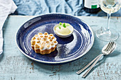 Lemon Meringue Pie with ice cream and mint leaves