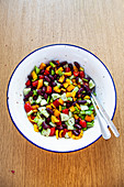 Salad with kidney beans, cucumber, pepper and tomatoes