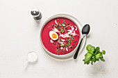 Polish beetroot soup with egg