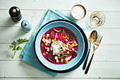 Beetroot soup with vegetables and sour cream