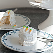 Mini vanilla cakes for Easter decorated with whipped icing and mini carrot