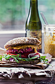 A beetroot quinoa burger with mustard sauce