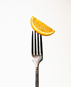 Orange slice on a fork