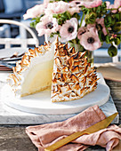 Pineapple and lime ice cream bomb with meringue topping