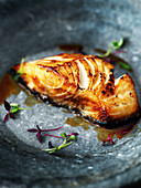 Black miso cod with micro herbs on stone